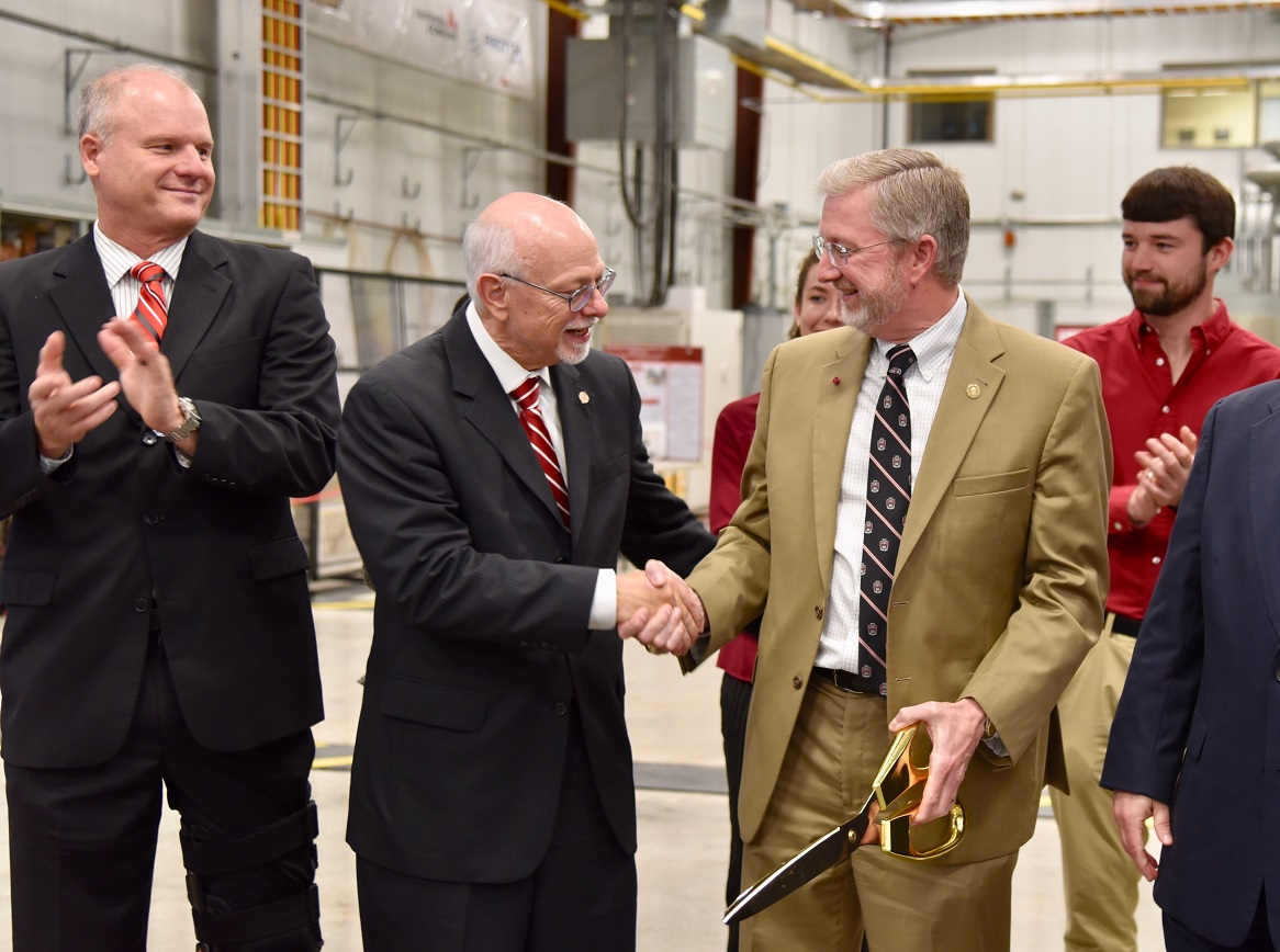 Chancellor Joseph Steinmetz congratulates Dr. Alan Mantooth at NCREPT ribbon cutting